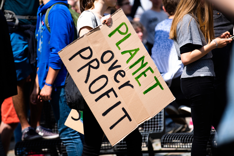 Planet over profit banner